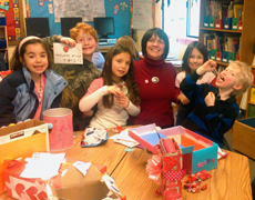 Students and a teacher making Valentines