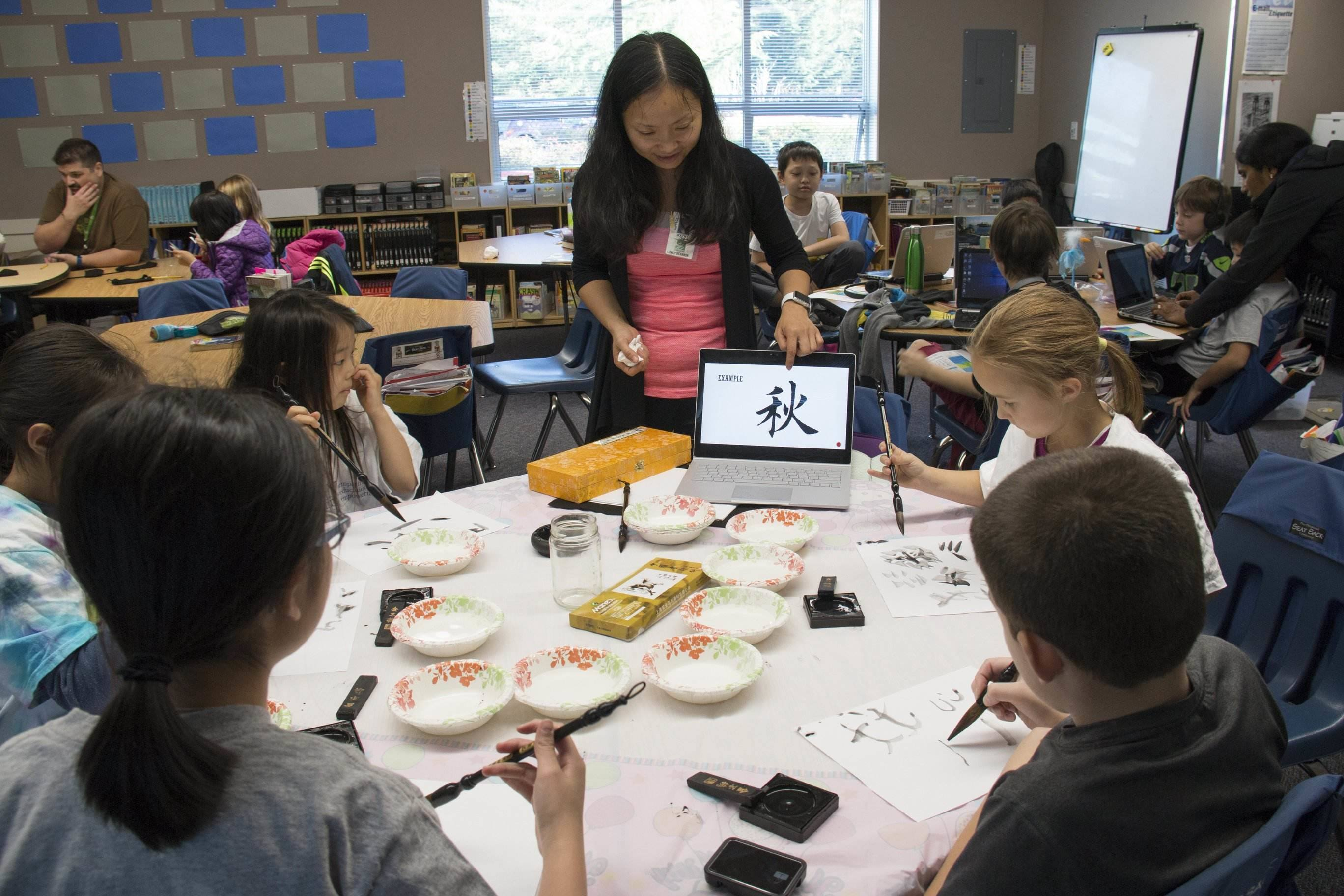 Students learning to write in a different language