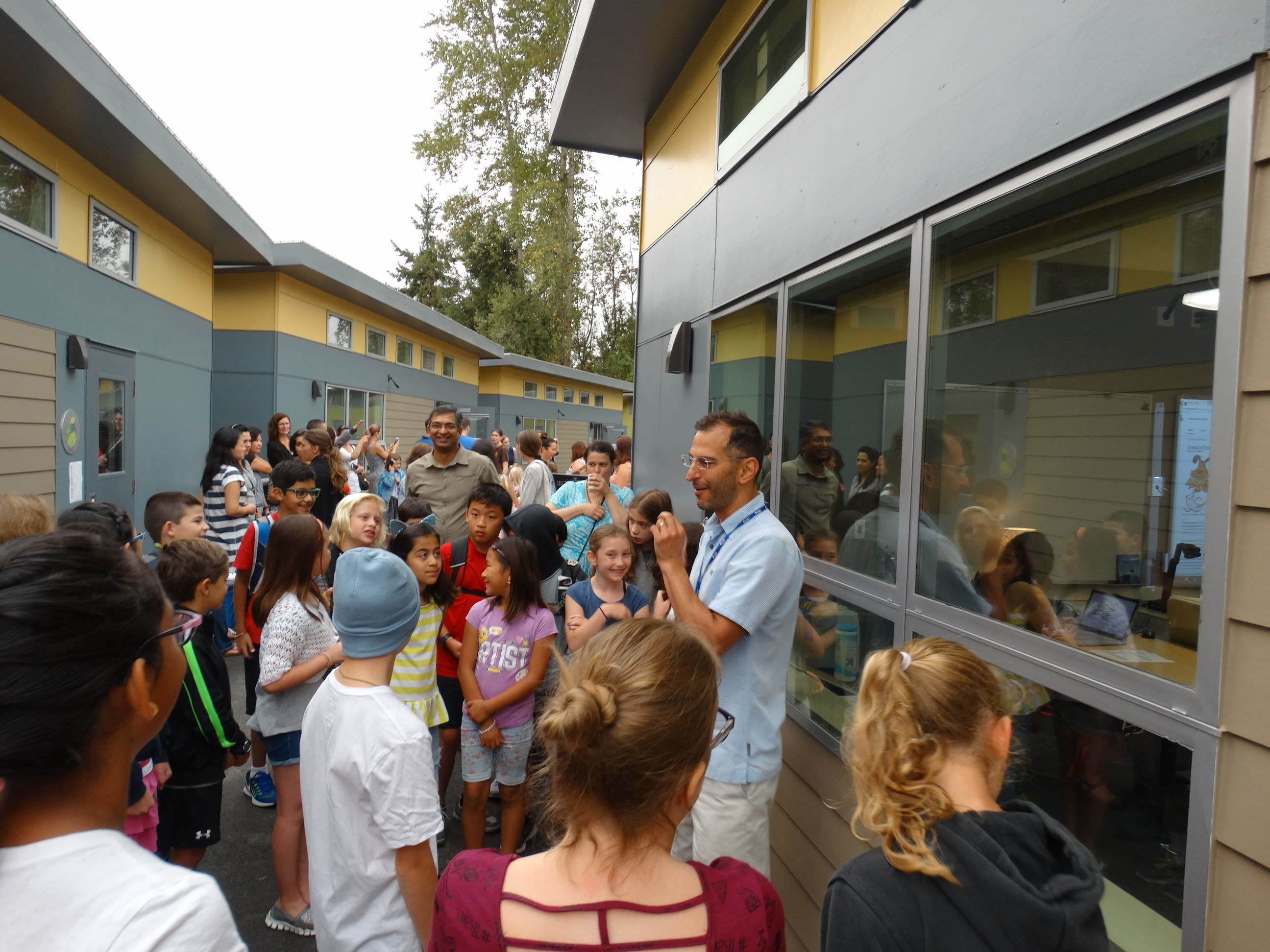 Teachers and students on the Explorer campus between buildings